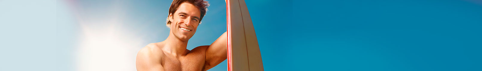 clean-cut man holding a surfing board